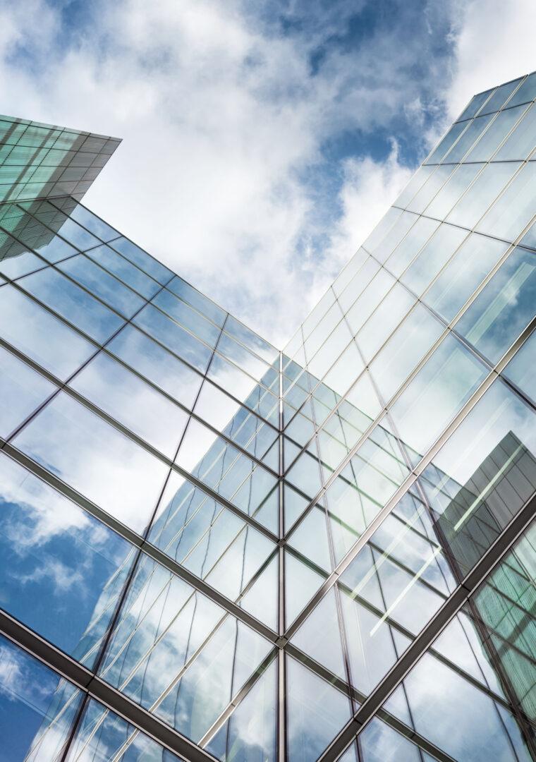 shutterstock_591644801 GLASS SKYSCRAPER FACING BLUE SKY